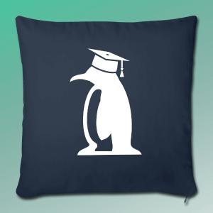 Kissen mit einem Pinguin, der einen Doktorhut trägt.