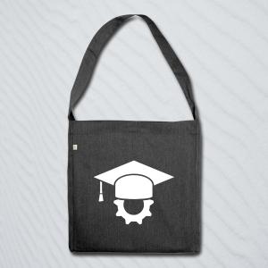 Tasche bedruckt mit einem Doktorhut auf einem Zahnrad.